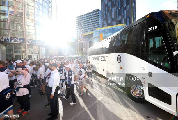 Fans line up as they wait to enter the Whiteout Street Party prior to NHL action between the Winnipeg Jets and the Nashville Predators in Game Six of...