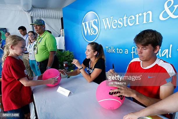Fans line up for a Kids Day autograph session with Jared Donaldson of the United States and Belinda Bencic of Switzerland on Day 1 of the Western...