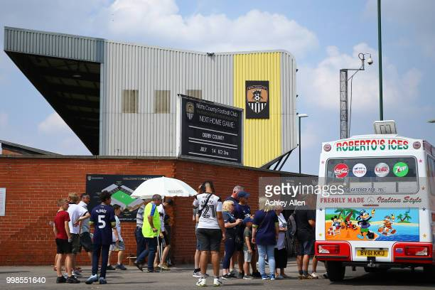 Fans line up for Ice Cream ahead of kickoff during a PreSeason match between Notts County and Derby County at Meadow Lane Stadium on July 14 2018 in...