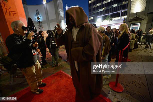 Fans line up for the opening night of Walt Disney Pictures and Lucasfilm's Star Wars The Force Awakens at TCL Chinese Theatre on December 17 2015 in...