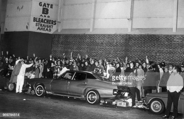 Fans line up outside Fenway Park in Boston on at night on Oct 8 waiting to buy the remaining World Series tickets The standing room only and bleacher...