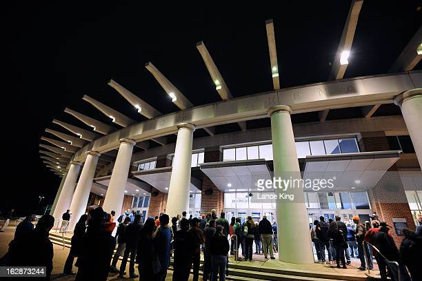 Fans line up outside John Paul Jones Arena prior to a game between the Duke Blue Devils and the Virginia Cavaliers on February 28 2013 in...