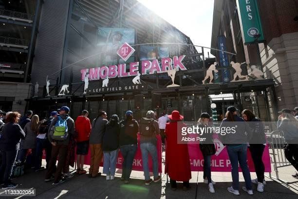 Fans line up outside of T-Mobile Park to watch the Seattle Mariners take on the Boston Red Sox during their Opening Day game at T-Mobile Park on...