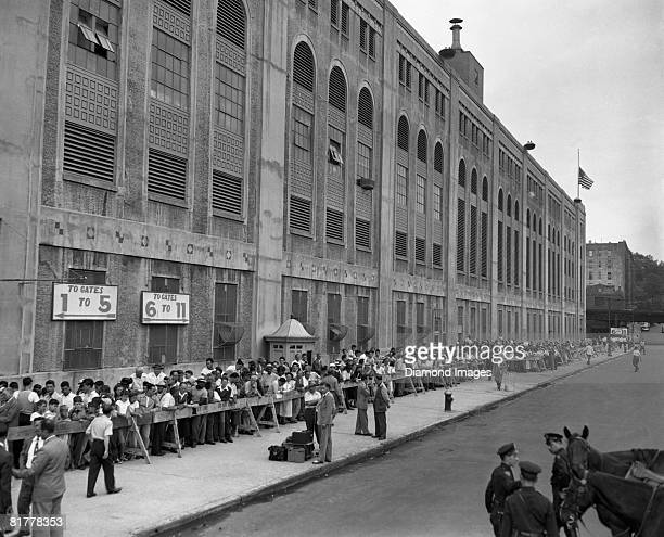 Fans line up outside of Yankee Stadium to pay their respects to Hall of Famer Babe Ruth whose body is lying in state for fans to pay their respects...