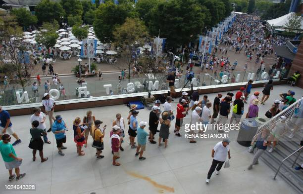 Fans line up to enter the new Louis Armstrong stadium to watch James Duckworth of Australia playing Andy Murray of Great Britain during their 2018 US...