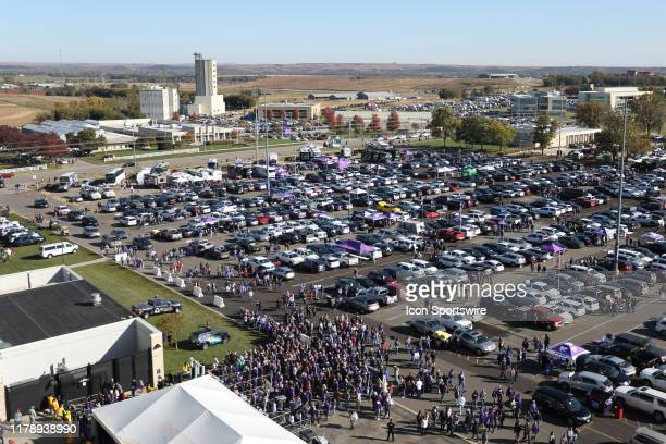 Fans line up to get into the stadium as the farmland looms in the horizon before a Big 12 football game between the Oklahoma Sooners and Kansas State...