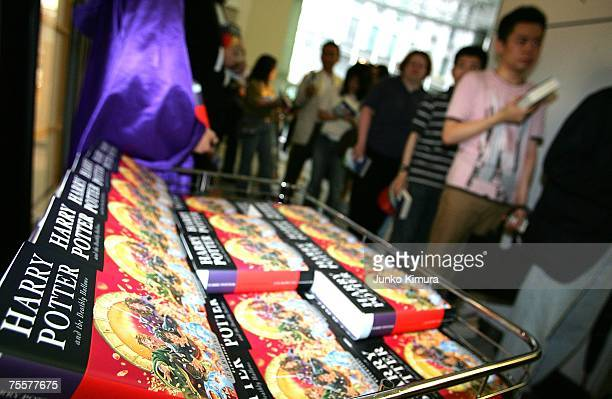 Fans line up to purchase author JK Rowling's new novel 'Harry Potter and the Deathly Hallows' at Maruzen bookstore on July 21 2007 in Tokyo Japan...