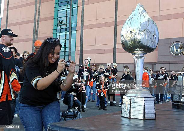 Fans line up to take photos of the Hart Trophy before the game between the Saint Louis Blues and Anaheim Ducks on October 16 2011 at Honda Center in...