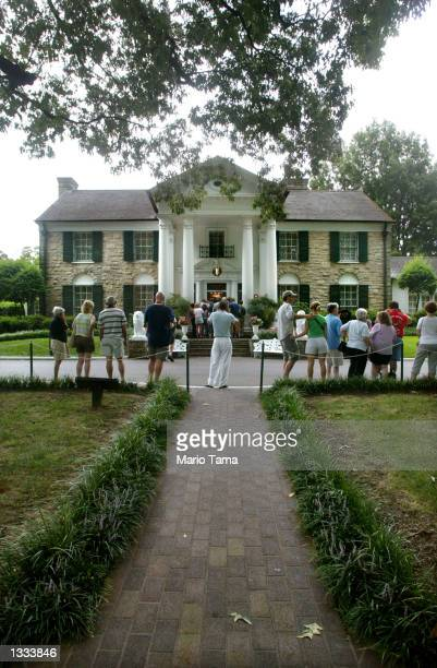 Fans line up to view Elvis Presley's Graceland home during Elvis Week on August 12, 2002 in Memphis, Tennessee. 75,000 fans are expected to attend...