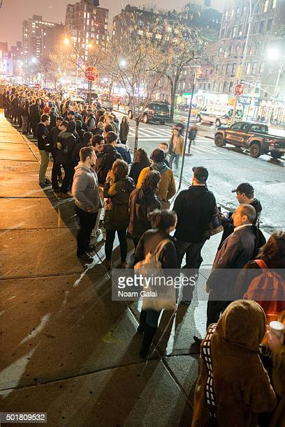 Fans line up to watch Star Wars The Force Awakens outside of AMC Loews Kips Bay 15 on December 17 2015 in New York City