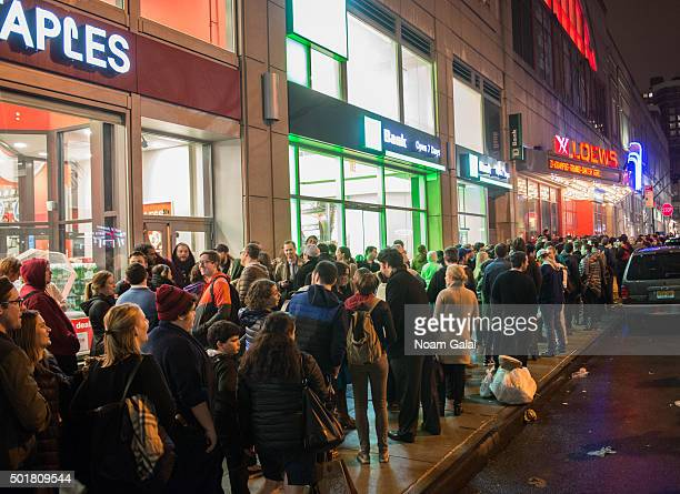 Fans line up to watch 'Star Wars The Force Awakens' outside of AMC Loews Kips Bay 15 on December 17 2015 in New York City