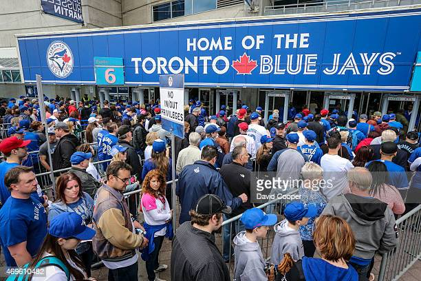 TORONTO ON APRIL 13 Fans lineup at gate 56 to pass thru the metal detectors at the home opener before the game between the Toronto Blue Jays and the...