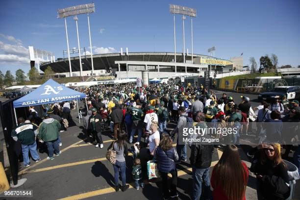 Fans lineup to enter the coliseum prior to the free game between the Oakland Athletics and the Chicago White Sox at the Oakland Alameda Coliseum on...