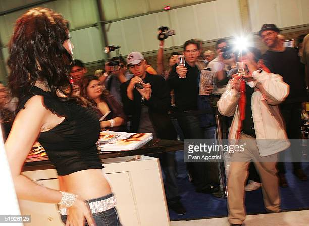 Fans lineup to get autographs and pose with adult film star Tera Patrick at the 2005 AVN Adult Entertainment Expo at the Sands Convention Center at...