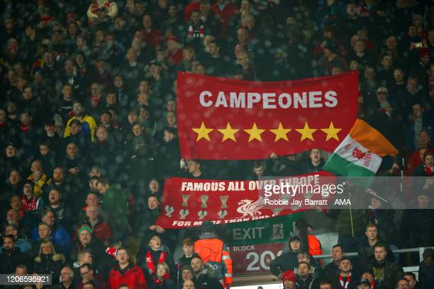Fans Liverpool hold up banners on The Kop ahead of the UEFA Champions League round of 16 second leg match between Liverpool FC and Atletico Madrid at...
