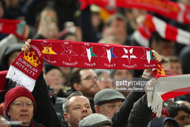 Fans Liverpool hold up scarfs on The Kop ahead of the UEFA Champions League round of 16 second leg match between Liverpool FC and Atletico Madrid at...