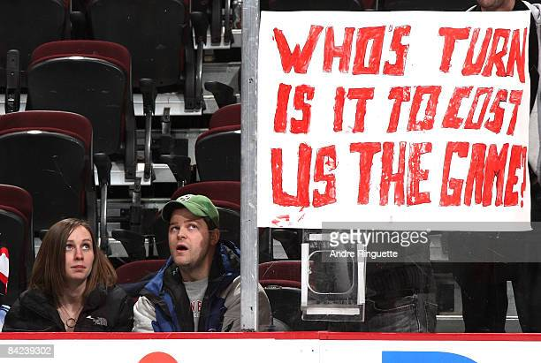 Fans look at a sign posted on the glass after the Ottawa Senators lose against the New York Rangers at Scotiabank Place on January 10 2009 in Ottawa...