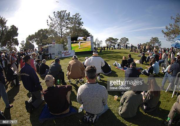 Fans look at action televised on a monitor during the third round of the PGA TOUR's 2006 Buick Invitational at Torrey Pines South in La Jolla,...