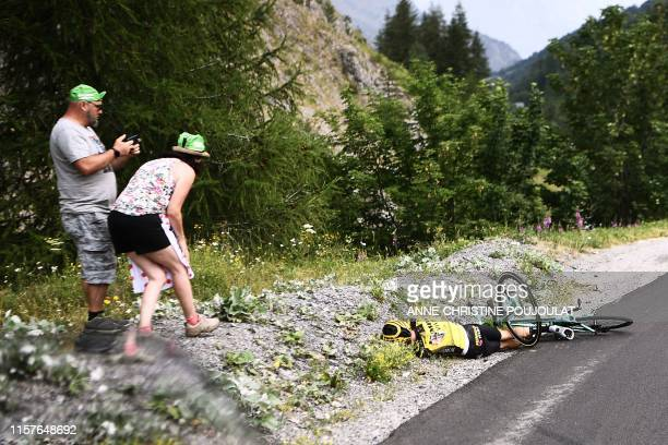 Fans look at New Zealand's George Bennett after a fall during the eighteenth stage of the 106th edition of the Tour de France cycling race between...