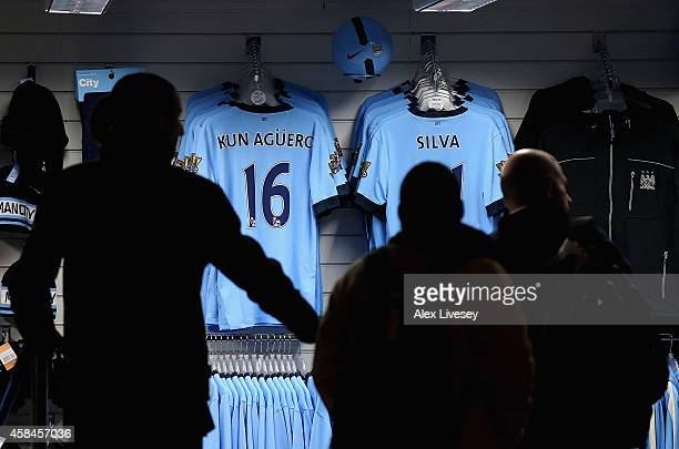 Fans look at replica shirts in the club shop prior to the UEFA Champions League Group E match between Manchester City and CSKA Moscow on November 5...