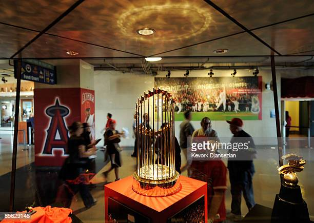 Fans look at the 2002 World Series trophy of Los Angeles Angels at Angels Stadium of Anaheim after the gates opened for the Los Angeles Angels home...