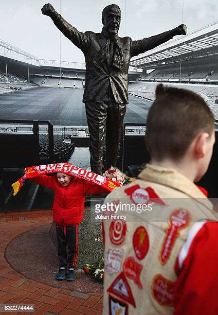Fans look at the Bill Shankly statue outide the stadium prior to the Premier League match between Liverpool and Swansea City at Anfield on January 21...