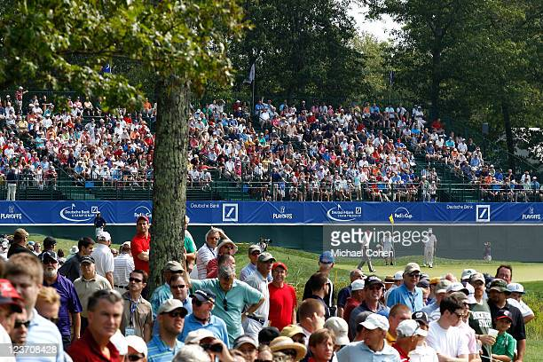 Fans look from the gallery on the 18th hole during the third round of the Deutsche Bank Championship at TPC Boston on September 4, 2011 in Norton,...