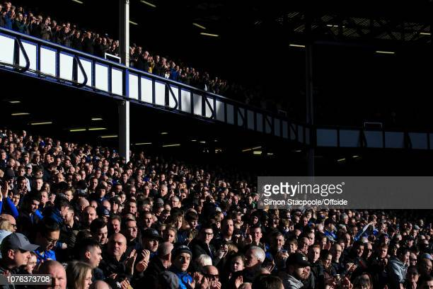 Fans look into the sunlight during the Premier League match between Everton and Leicester City at Goodison Park on January 1 2019 in Liverpool United...