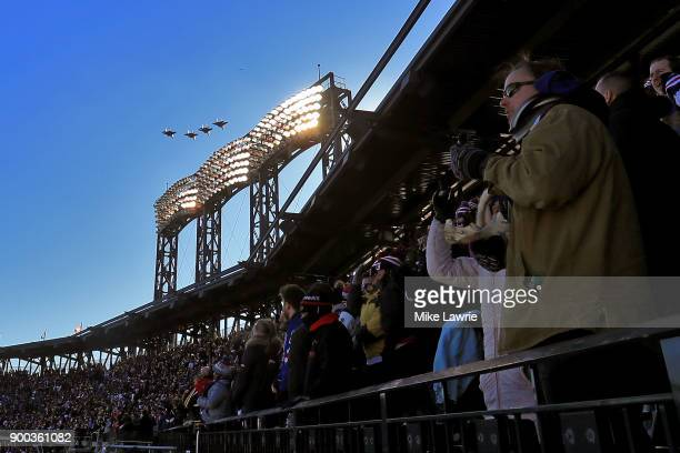 Fans look on as jets flyover the stadium before the New York Rangers take on the Buffalo Sabres during the 2018 Bridgestone NHL Winter Classic at...