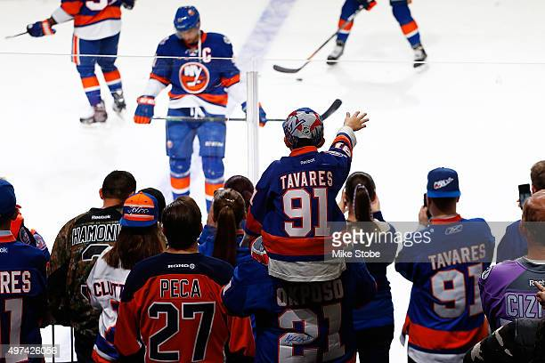 Fans look on as John Tavares of the New York Islanders warms up prior to the game against the Arizona Coyotes at the Barclays Center on November 16...