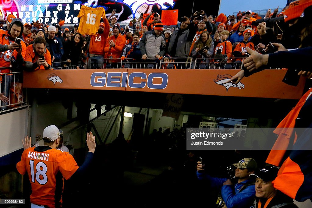 Fans look on as Peyton Manning #18 of the Denver Broncos walks off the field after defeating the New England Patriots in the AFC Championship game at Sports Authority Field at Mile High on January 24, 2016 in Denver, Colorado. The Broncos defeated the Patriots 20-18.
