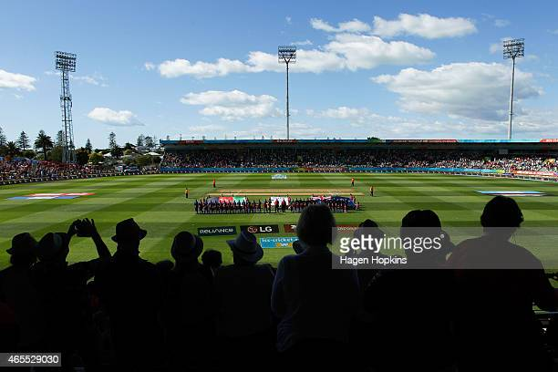 Fans look on as players line up for the national anthems during the 2015 ICC Cricket World Cup match between New Zealand and Afghanistan at McLean...