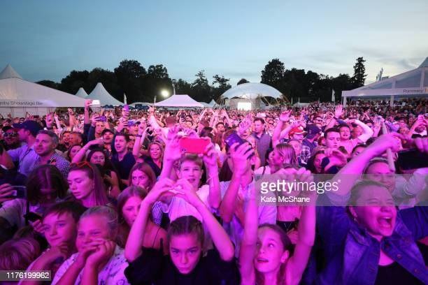 Fans look on as Rudimental perform on the Slingsby Show Stage following Day Three of the BMW PGA Championship at Wentworth Golf Club on September 21...
