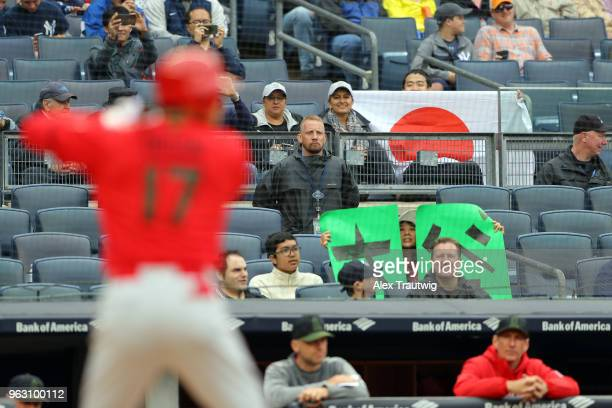 Fans look on as Shohei Ohtani of the Los Angeles Angels bats during a game against the Los Angeles Angels at Yankee Stadium on Sunday May 27 2018 in...