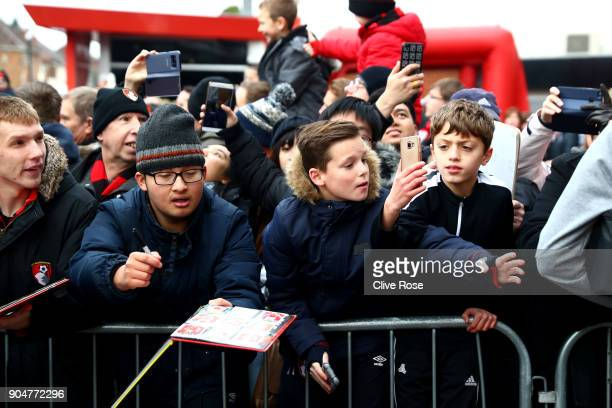 Fans look on as the Arsenal team arrives at the stadium prior to the Premier League match between AFC Bournemouth and Arsenal at Vitality Stadium on...