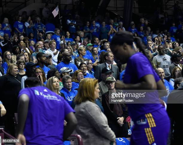 Fans look on as the Los Angeles Sparks leave the court prior to the National Anthem before Game Two of the WNBA Finals against the Minnesota Lynx on...