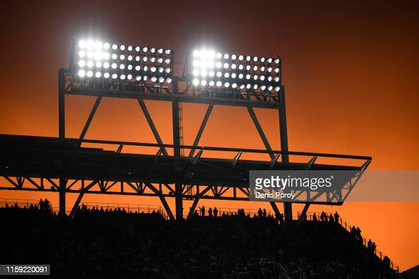Fans look on as the sun sets during the second inning of a baseball game between the San Diego Padres and the St. Louis Cardinals at Petco Park June...