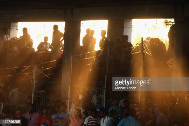 Fans look on as the sunsets during the 2011 ICC World Cup QuarterFinal match between Australia and India at the Sardar Patel Stadium on March 24 2011...