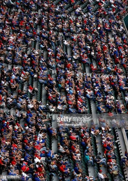 Fans look on as the Texas Rangers take on the Toronto Blue Jays in the fourth inning on Opening Day at Globe Life Field on April 05, 2021 in...