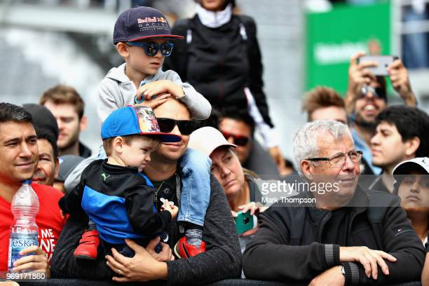 Fans look on at the drivers autograph signing during previews ahead of the Canadian Formula One Grand Prix at Circuit Gilles Villeneuve on June 7...
