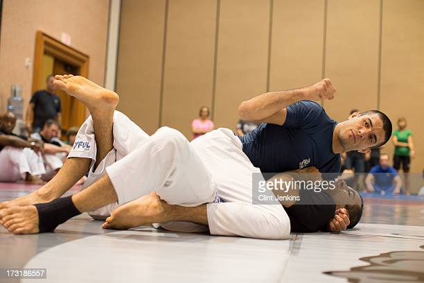 Fans look on during a jiujitsu seminar during day one of the UFC Fan Expo Las Vegas 2013 at the Mandalay Bay Convention Center on July 5 2013 in Las...
