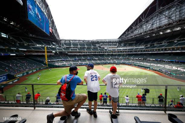 Fans look on during batting practice before the Texas Rangers take on the Toronto Blue Jays in the Rangers home opener at Globe Life Field on April...