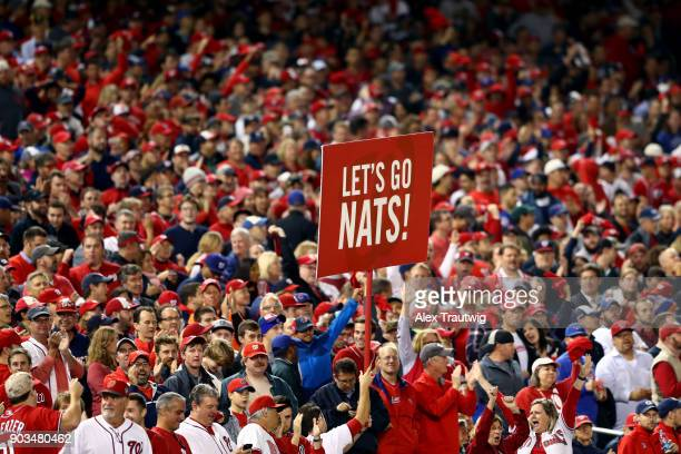 Fans look on during Game 5 of the National League Division Series between the Chicago Cubs and the Washington Nationals at Nationals Park on Thursday...