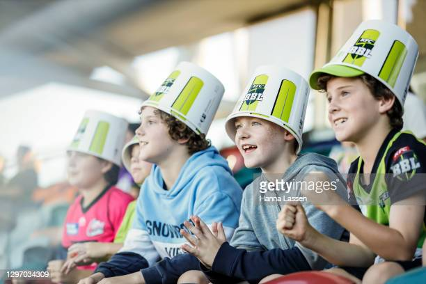 Fans look on during the Big Bash League match between the Sydney Thunder and the Hobart Hurricanes at Manuka Oval, on January 18 in Canberra,...
