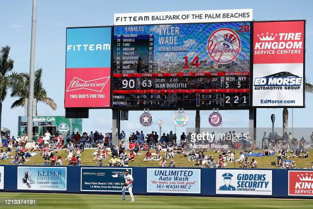 Fans look on during the bottom of the fifth inning of a Grapefruit League spring training game between the Washington Nationals and the New York...