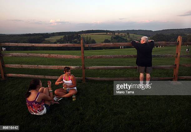Fans look on during the concert marking the 40th anniversary of the Woodstock music festival August 15 2009 in Bethel New York On August 1517 in 1969...