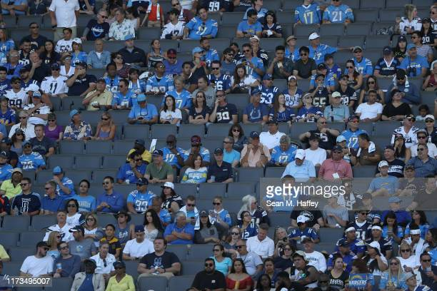 Fans look on during the first half of a game between the Los Angeles Chargers and the Indianapolis Colts at Dignity Health Sports Park on September...
