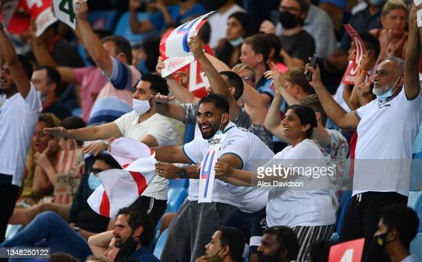 Fans look on during the ICC Men's T20 World Cup match between England and Windies at Dubai International Stadium on October 23, 2021 in Dubai, United...