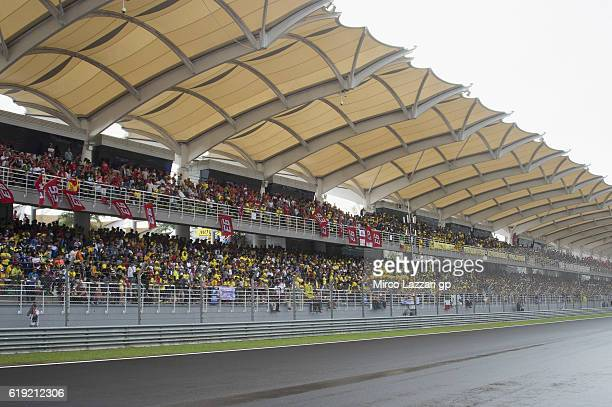 Fans look on during the MotoGP race during the MotoGP Of Malaysia Race at Sepang Circuit on October 30 2016 in Kuala Lumpur Malaysia