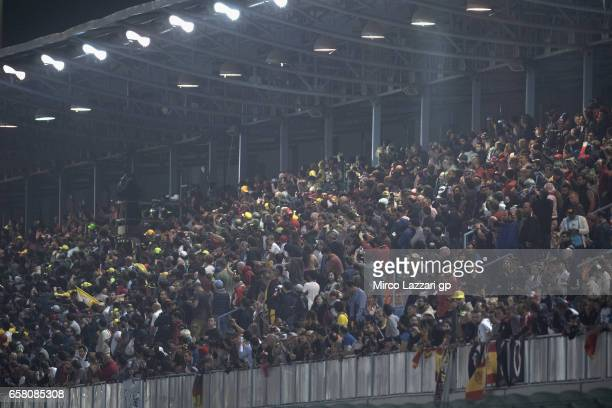 Fans look on during the MotoGP race during the MotoGp of Qatar Race at Losail Circuit on March 26 2017 in Doha Qatar